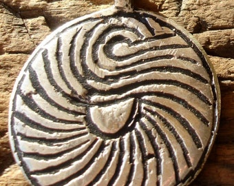 Moroccan  large round  pendant with hand engraved spiral lines