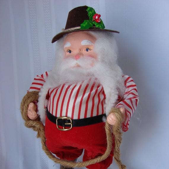 Items similar to super cute alpine cowboy santa claus