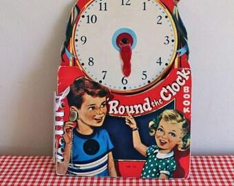 vintage 1950s children's book -  'ROUND the CLOCK' board book