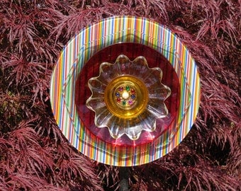 Glass Plate Garden Art Flower Ensemble with Plates, Glass, Ceramic, Metal, Jewels, and other Treasures