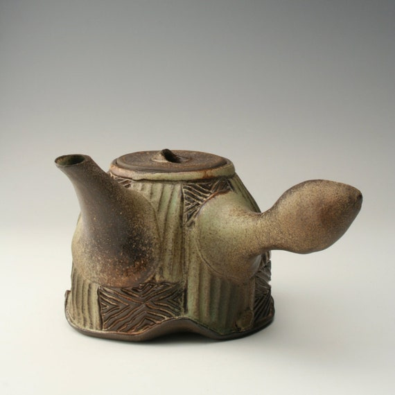 Ceramic teapot with geometric carving pottery