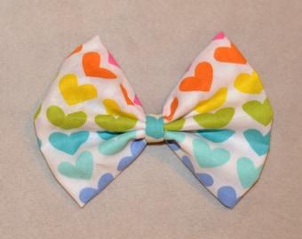Rainbow heart bow.