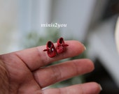 Handmade little baby shoes in incredibly soft and thin red leather in scale 1:12