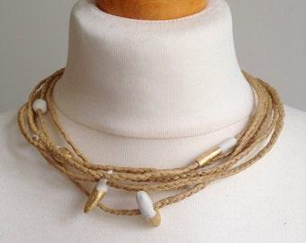 raffia necklace, porcelain and gold leaf