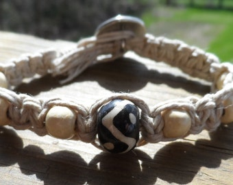 Natural hemp bracelet with ying-yang center bead and white wood beads with button closure