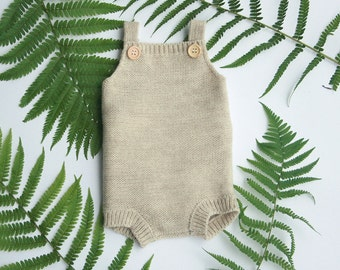 Knitted baby romper in wool alpaca blend, available in many colors