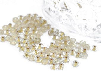 Faceted Small Rondelles in Clear with Gold Center 4mm 24pcs