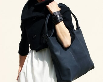 anthracite leather bag with handles and shoulder strap