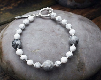 Howlite and marble beaded bracelet with feather charm