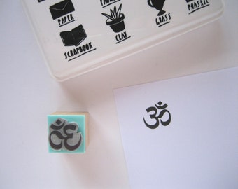 S Size (Small). OM or AUM. Rubber stamp