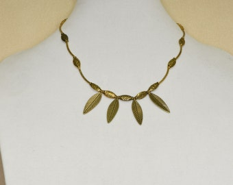 Necklace of antique looking gold with 4 leaves