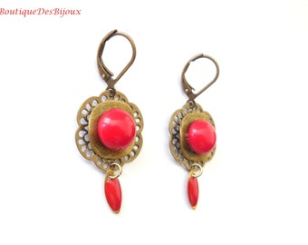 Filigree earrings with red cabochon