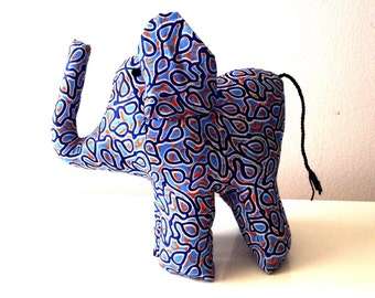 "Large african stuffed Elephant #011204 made by Ugandan Disabled Women. 10"" height and 8"" wide."