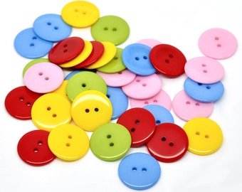 25 Mixed Resin Buttons 23mm. Red Mix. Ideal for sewing, scrap booking, card making, jewellery, and other craft projects