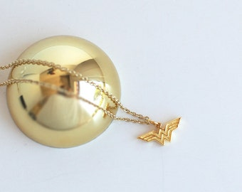 Tiny Wonder Woman necklace made with sterling 925 silver and 18k gold