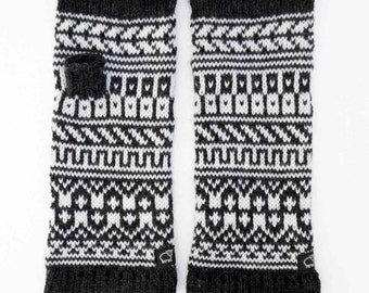 Fair isle knitted fingerless mittens.