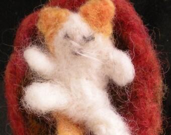 Little needle felted kitten on a mat