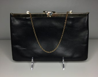 vintage black leather Etra purse with chain and hinged top