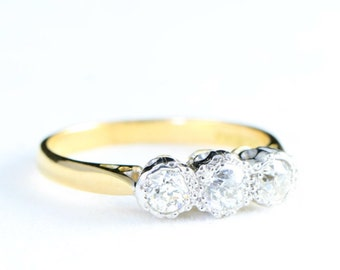 Edwardian 3 stone old european cut diamond engagement ring in platinum and 18 carat gold
