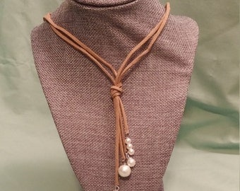 Faux pearl and suede dangle necklace