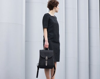 Black leather backpack with laptop compartment