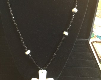 Beaded necklace with cross