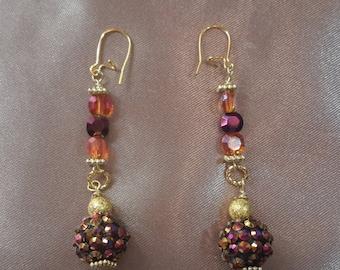 Glitzy gold ball dangle earrings