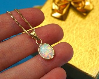 Opal pendant etsy 14k gold pendant white opal pendant solid gold pendant gold opal pendant aloadofball Image collections