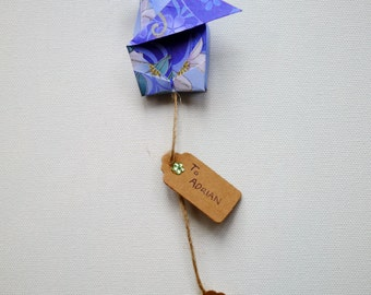 Origami crane gift bow with tags