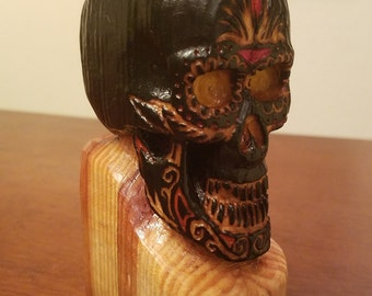 Hand carved wooden skull