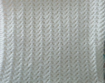Hand knit White baby blanket with pink edging