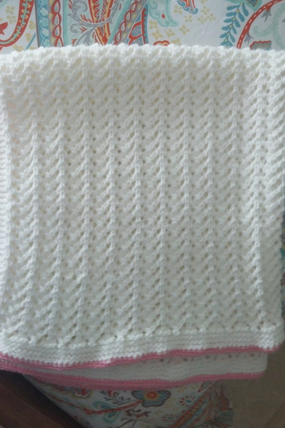 Knitting Edges For Baby Blankets : Hand knit white baby blanket with pink edging