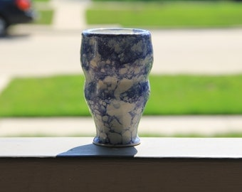 White Cup with Blue Bubbles
