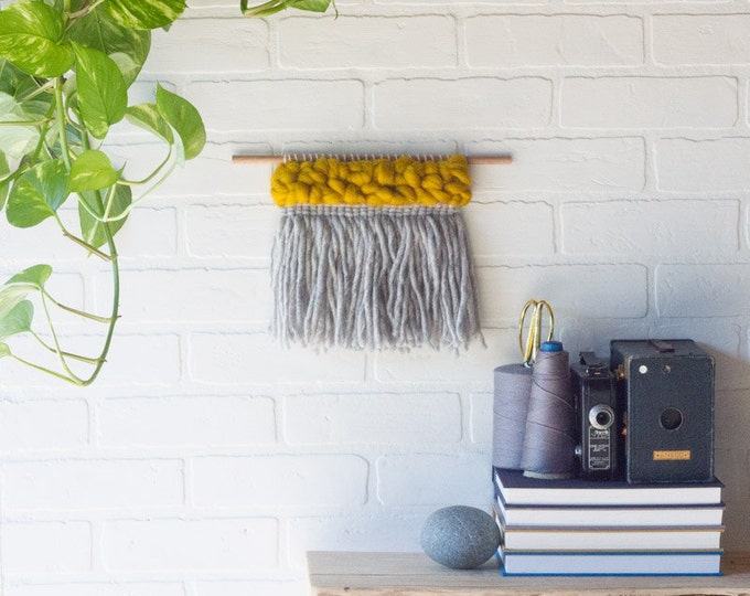 macrame wall hanging ombre cotton on a light wood dowel
