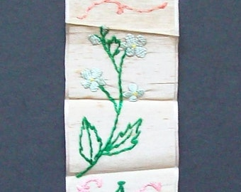 Hand made ribbon  bookmark with hand embroidered flowers and message 'Best Wishes Xmas.