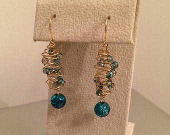 Elegant crystal earrings hand wrapped with gold wire and dangling beads