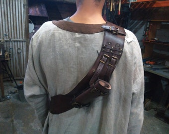 Shoulder bag with cover of sword