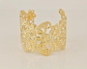 Gold  filigree metal cuff bangle bracelet cut out scroll floral pattern
