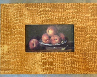 Vinegar painted wood picture frame in ocher with fruit