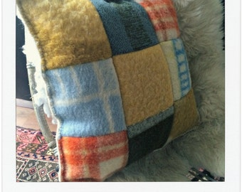Handmade cushion of old vintage blankets
