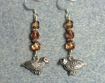 Silver partridge charm dangle earrings adorned with rosaline Czech glass beads.