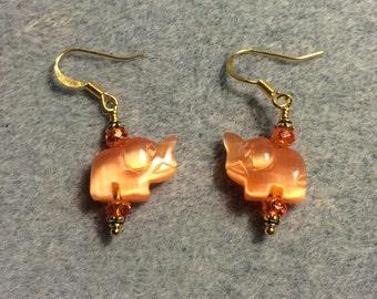 Small orange fiber optic cats eye glass elephant bead earrings adorned with orange Chinese crystal beads.