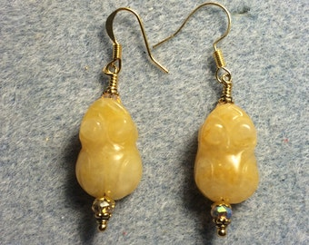 Yellow jadeite gemstone frog bead earrings adorned with yellow Chinese crystal beads.