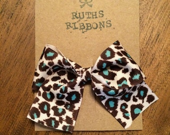 Turquoise leopard bow