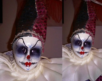 This is Miss Remi. She is my creepy clown doll. Horror doll, creepy clown doll, gothic doll, zombie doll, Halloween doll, haunted doll