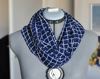Blue scarf with white crossed lines