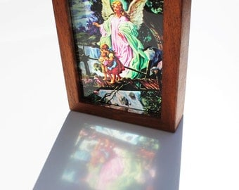 Guardian angel and children crossing the bridge lightbox see through print that glows in natural light