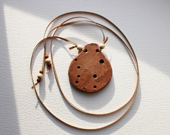 Plywood Pendant, terracotta color ocarina shaped, hand painted, glossy craklé finish, grosgrain ribbon with wooden pearls FREE SHIPPING