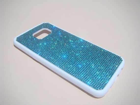 "Galaxy S7 ""Edge"" Aquamarine Blue Diamond Crystals on White Rubber Case. Velvet/Silk Pouch Bag Included, Genuine Rangsee Crystal Cases."