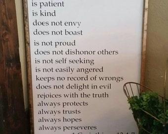 1 corinthians 13  large love is patient love is kind bible scripture sign. Love never fails. Love chapter sign